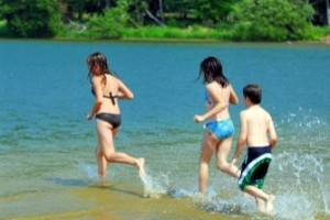 children-running-lake