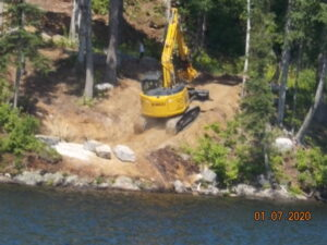 Image of excavator working next to shoreline